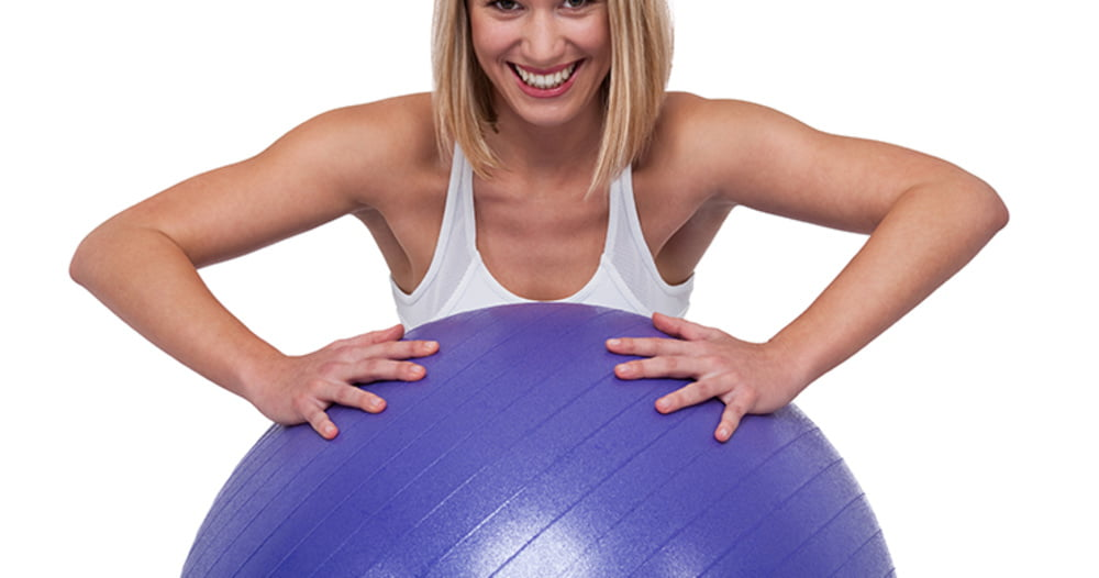 woman holding an exercise ball