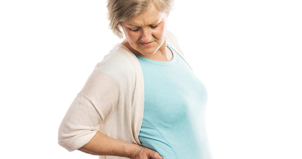 Woman experiencing backpain